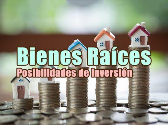 imagen del artículo sobre bienes raíces en la que aparecen unas casas sobre montons de monedas que van creciendo